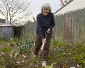 Pat Scott in her garden.