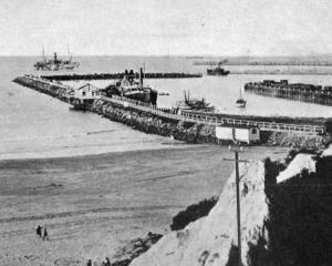 Timaru Harbour, showing the extensive breakwater. - Otago Witness, 30.10.1918.
