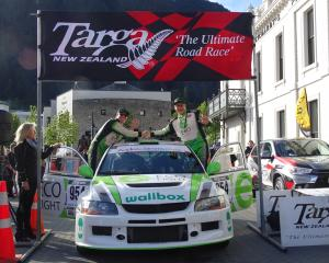 Targa Rally winners Glenn Inkster (left) and co-driver Spencer Winn at the finish line in...