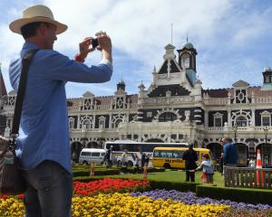 Raymond Van Der Heiden, of Holland, photographs the Dunedin Railway Station yesterday. Plans for...