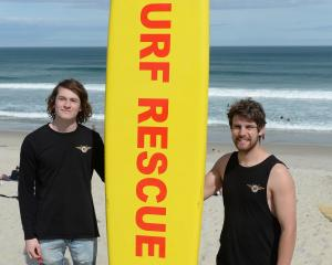 St Kilda surf life-savers Danyon Noakes (17, left) and Duncan New (19) hold the board they used...