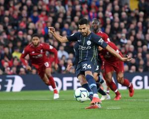 Manchester City's Riyad Mahrez misses his penalty against Liverpool. Photo: Getty Images
