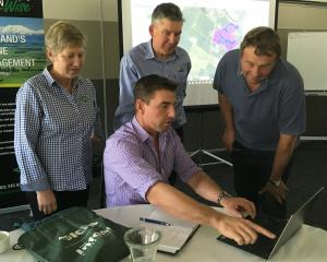 Explaining the benefits of Satellite Imagery to Mid Canterbury farmer Chris Ford, of Ashburton...