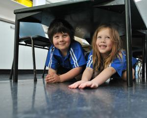 Carisbrook School pupils Jake Cairns (6) and Makayla Donnelly (6) duck for cover in Dunedin as...