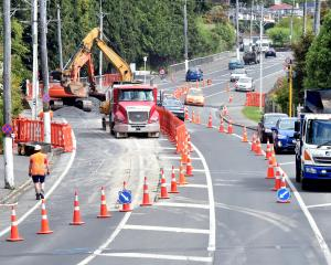 Fulton Hogan contractors have begun digging trenches in Taieri Rd, near Wakari Hospital, to house...