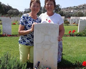 Rosa Westgarth (left) and Jan Gibson at Ted d'Auvergne's grave in Crete earlier this year. Photos...
