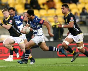 TJ Faiane breaks away to score a try for Auckland against Wellington last night. Photo: Getty Images