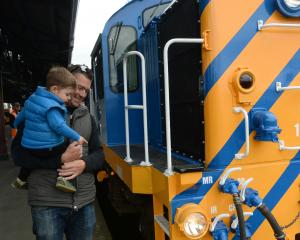 Paul Robertson, of Wanaka, takes a close look at diesel electric locomotive Dj 1221 with his son...