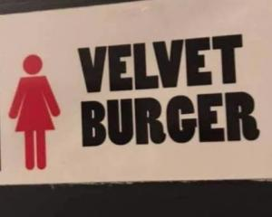 This sign in Velvet Burger's Fort St store in Auckland CBD, apparently indicated three self...