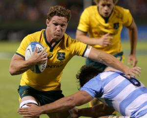 Michael Hooper is tackled by Pablo Matera during a match between Argentina and Australia in Salta...