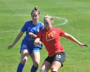 Southern United's Britney-Lee Nicholson competes with Canterbury United's Whitney Hepburn for the...