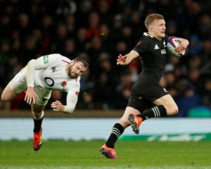 All Blacks fullback Damian McKenzie escapes the desperate defence of his England counterpart,...