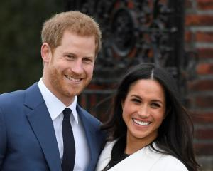Prince Harry with Meghan Markle. Photo: Reuters