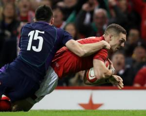 George North dives over to score the first try for Wales. Photo: Reuters
