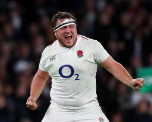 England's Jamie George celebrates after the match. Photo: Reuters