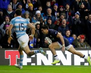 Sean Maitland crosses to score for Scotland against Argentina. Photo: Reuters