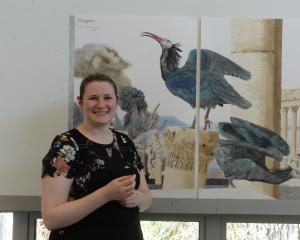 Elaine Mitchell (20) with one of her natural history-inspired works, Palmyrene, depicting the...