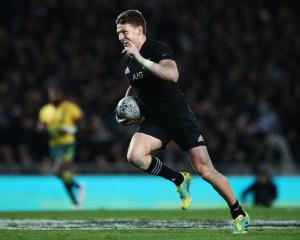 Beauden Barrett on the way to scoring one of his four tries against the Wallabies. Photo: Getty...