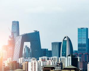 Beijing's population has risen by two thirds since 1998, while energy consumption has more than...