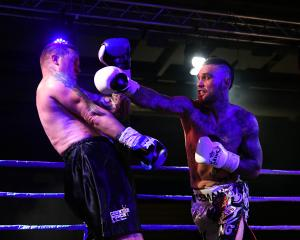 Dunedin boxer Kurt Winklemann in the ring against Waikato's Nigel Elliott at the Edgar Centre on...