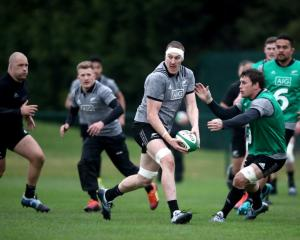 Brodie Retallick looks to pass the ball during All Blacks training yesterday. Photo: Getty Images