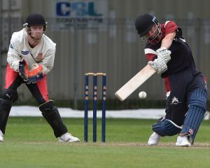 Carisbrook-Dunedin opener Camden Hawkins launches into a big shot at Tonga Park on Saturday....