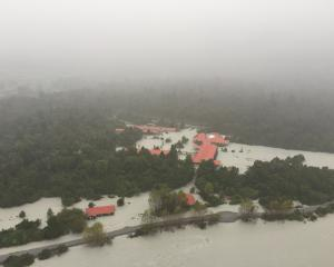 The flooded Waiho River rages through the Scenic Hotel at Franz Josef Glacier in March 2016....