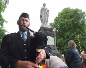 Jock Scott, great-nephew of Dr Margaret Cruickshank, plays the bagpipes at a wreath-laying...