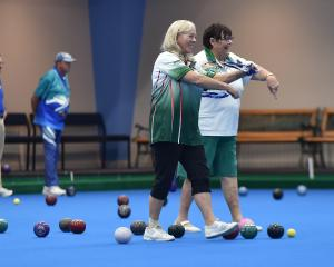 Barbara Walker (left), of Dunedin, and Robin Petrus, of Mossman, North Queensland, play in an...