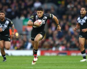 Dallin Watene-Zelezniak on the run for the Kiwis against England. Photo: Getty Images
