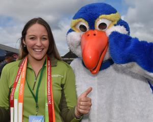 Department of Conservation community ranger Jesikah Triscott and a penguin mascot (aka Alex...