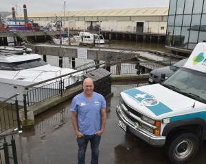 Roving doctor Tom Mulholland stands by his boat at Steamer Basin yesterday. Photo: Gregor Richardson