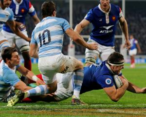 Guilhem Guirado scores the third try for France against Argentina. Photo: Reuters