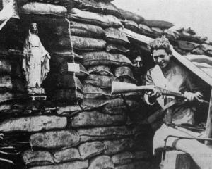 A dug-out near the front lines in northern France with a statue of the Virgin Mary near the...