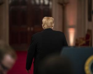 US President Donald Trump walks away after a media statement. Photo: Getty Images