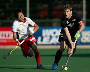 Black Sticks defender Blair Tarrant (right) will wear the armband at the Hockey World Cup later...