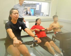 Taiwan rowers (from left) Chen Chao-Chen, Wang Yu-Wen and Chiang Shen-Hoa row in the School of...