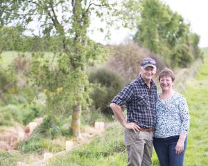 Farm owners Tony and Raewyn van Gool at a riparian planting at their Mokotua farm in Southland...