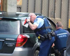 Police investigate a car which was abandoned at the former Invercargill Railway Station in Leven...