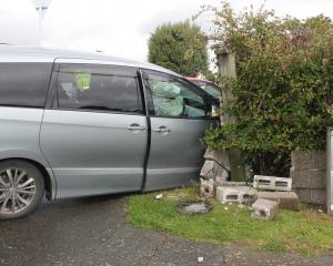 A car ploughed through a fence after colliding with another vehicle in Invercargill this morning....