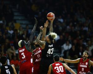 Isaac Fotu (shooting) will not travel for the upcoming round of Fiba World Cup qualifying. Photo:...