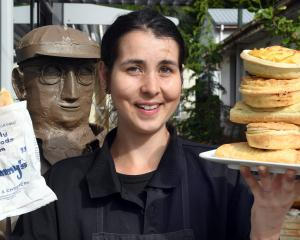 Jimmy's Pies shop assistant Meghan Scanlan with a mince and cheese pie (left), and a stack of...