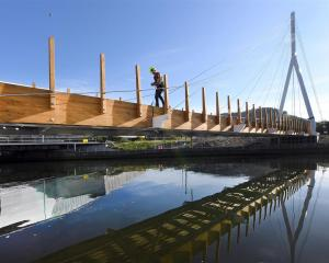 Water of Leith bridge project manager Walter Reikes, of Edifice construction, works on decking...