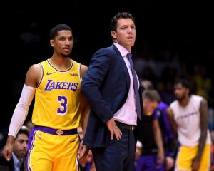 Los Angeles Lakers head coach Luke Walton and player Josh Hart watch on during the team's game...