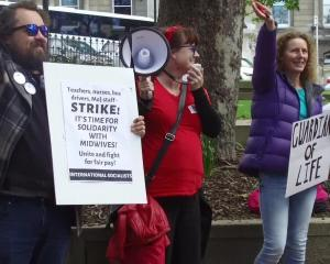 A small but vocal group of midwives and their supporters took to the Octagon to demonstrate as part of today's strike action. Screengrab: Craig Baxter