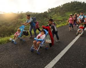 Members of the Central American migrant caravan move to the next town in Matias Romero, Mexico....