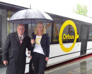 Orbus driver Stephen Poole watches as Queenstown Lakes Mayor Jim Boult and Otago Regional Council...
