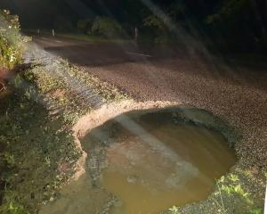 A culvert appears to have collapsed in Westview Rd, Weston, causing flooding and creating a hole...
