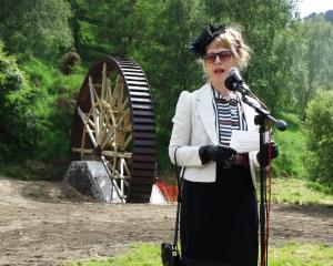 Phoenix Mill Restoration Trust chairwoman Carol Berry speaks at the handover ceremony of the...