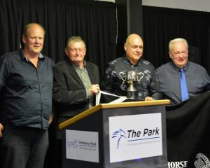 Owners (from left) Stephen Pulley, Graeme Anderson, Tony Gow and Ray Chalkin accept the  horse of...